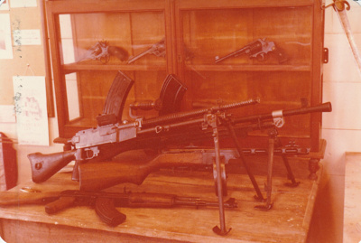A display of firearms in Pakuranga School in Howick Historical Village as part of the International Military Arms Society display.; La Roche, Alan; 23 August 1980; P2021.100.04