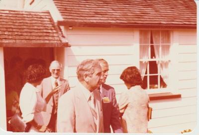 Alan Highet, MP, leaving a cottage.; 8/03/1980; 2019.100.28