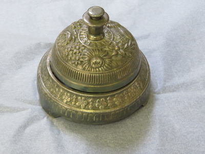 Silver bell from Simla. Circular bell with two lev...