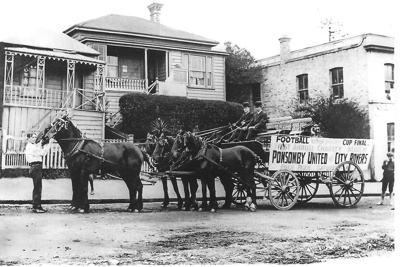 Horse drawn Crawford bus (uncovered wagon) decorat...