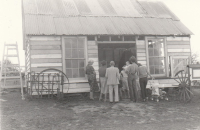A group of people outside the Forge in Howick Historical Village under construction.; La Roche, Alan; 5 April 1981; P2021.06.05