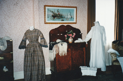 A display of gowns in Puhinui at HHV.; La Roche, Alan; 2003; 2019.229.02