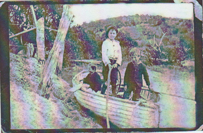 3 boys in a dinghy on Manurewa Stream.; 2018.372.01