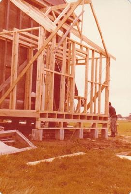 Building the toilet block behind Pakuranga School at the Howick Historical Village. David Mercer is the builder.; La Roche, Alan; August 1979; P2020.51.05