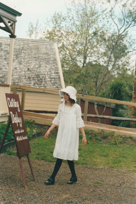 Laura Doughty walking towards a clothing display in Puhinui on an HHV Live Day. ; Palmer, Ros; October 2003; 2019.198.12