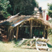 Hemi Pepene's whare (cottage) at the Howick Historical Village, showing the thatched roof and iron.; La Roche, Alan; December 2000; 2020.96.04