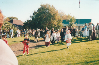 Visitors at the opening of Puhinui after its removal to the site near the village entrance. ; Schofield, Helen; 16 May 2004; P2020.15.03