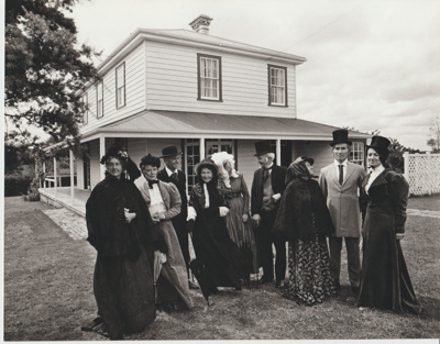 Nine people in costume on the lawn outside Bell House.; Auckland Star (Harold Paton); 20/11/1976; 2018.057.56