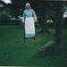 Sue Popping on stilts in Howick Historical Village.; La Roche, Alan; P2021.125.05
