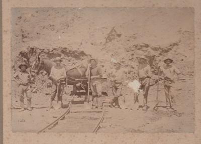 5 unidentifed men holding shovels; 2018.363.13