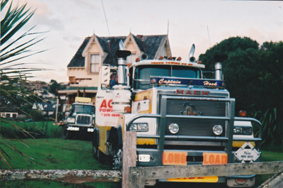 Ace Towing Co. and a Johnson's truck moving Puhinui onto its new site in the Howick Historical Village. ; Alan La Roche; May 2002; P2020.11.13