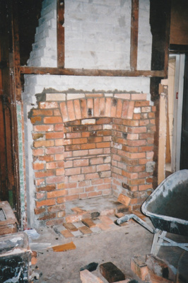 The fireplace and chimney in Puhinui kitchen under construction by Gary McCarthy.; Alan La Roche; September 2003; P2020.14.21