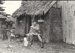 Arthur White in front of the Sod Cottage, Howick Historical Village  ; 6 November 1980; P2020.43.16