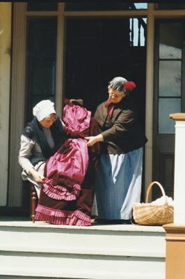 Barbara Doughty and Gloria with a dress to be used in the fashion parade at Puhinui on an HHV Live Day. ; Palmer, Ros; October 2003; 2019.198.22