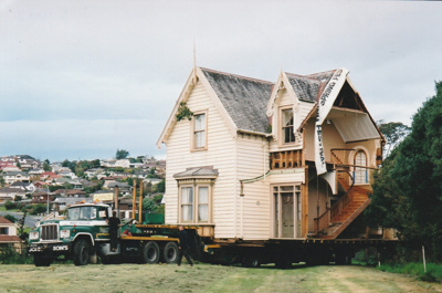 A Johnson's truck delivering half of Puhinui onto its new site in the Howick Historical Village.; Alan La Roche; May 2002; P2020.11.16