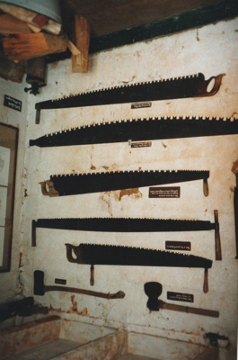 Saws and axes hanging on the wall in Maher-Gallagher Cottage in the Howick Historical Village. ; La Roche, Alan; P2020.95.03