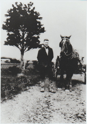 A farm worker standing beside a horse and cart; 1927; 2018.160.79