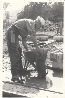 Arthur White laying the foundations for the Coachhouse in the Howick Historical Village.; Groethe. Julia; 1975; P2021.23.02