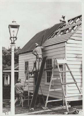 Working bee on the roof of Sergeant Barry's cottage in the Garden of Memories.; 1/03/1974; 2019.094.01