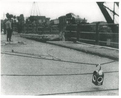 Mahua crane demolishing Panmure bridge; 1959; 2017.285.28