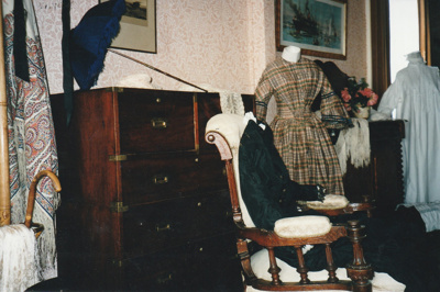 A display of gowns in Puhinui at HHV.; La Roche, Alan; 2003; 2019.229.03