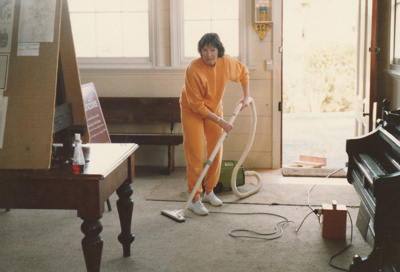 A member of the Bucklands Beach Lioness Club cleaning Pakuranga School, HHV.; La Roche, Alan; August 1989; P2020.61.01