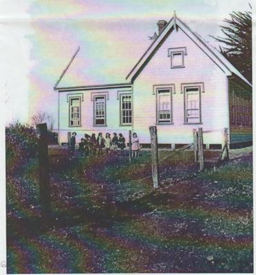 Girls standing in fron of East Tamaki School house c1940.; c1940; 2019.046.07