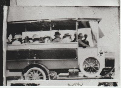 Crawford's bus with side curtains rolled up; c1930; 2017.494.65