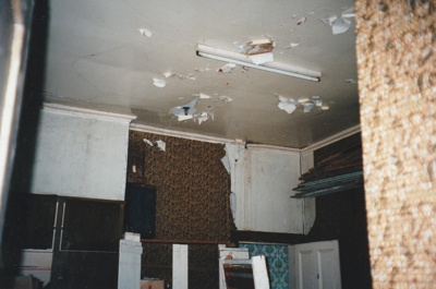 Puhinui kitchen ceiling before restoration, showing a fluorescent light and the top of the walls.; Alan La Roche; May 2002; P2020.11.45