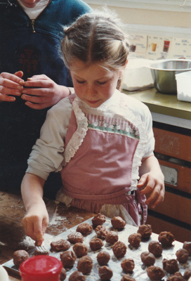 A schoolgirl making biscuits in Pakuranga School in the Howick Historical Village.; P2020.64.07