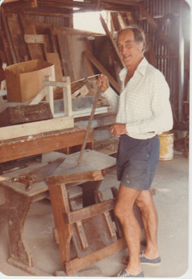 Doug Duncalf repairing school desks at Howick Historical Village.; 26/02/1983; 2019.129.09