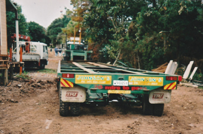 A Johnson's Heavy truck and trailer ready to move Puhinui to its new site in the Howick Historical Village. ; Alan La Roche; May 2002; P2020.11.04