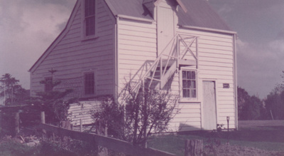 Side view of the Coachhouse in the Howick Historical Village. ; April 1983; P2021.23.06