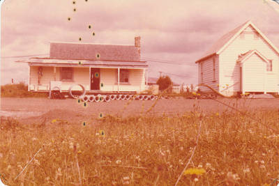 Drainage pipes awaiting installation outside Brindle Cottage and the Courthouse in the Howick Historical Village.; January 1980; P2021.48.01