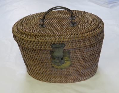 Sewing basket made of fine woven cane. Lined with ...