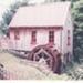 Bycroft's flour mill and water wheel in Howick Historical Village.; La Roche, Alan; 2003; P2021.86.02