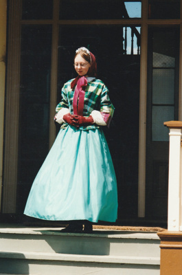 Victoria in costume on Puhinui verandah on HHV Live Day. ; Palmer, Ros; October 2003; 2019.198.03