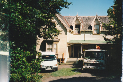 A Johnson's truck and a pilot vehicle preparing to move Puhinui to its new site in the Howick Historical Village.; Alan La Roche; May 2002; P2020.11.33
