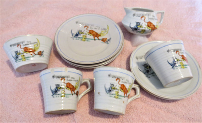Child's tea set, comprising plate, cups and saucer...