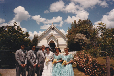 A wedding party outside the church in Howick Historical Village. ; P2021.131.01