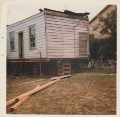 Sergeant Barry's cottage on blocls in the Garden of Memories,awaiting removal.; La Roche, Alan; 1/04/1974; 2019.094.04