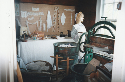 A sewing and washing display in the front room of Johnson's cottage in Howick Historical Village.; La Roche, Alan; November 1989; P2020.122.02