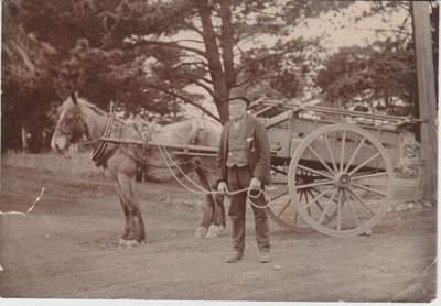 Mr Crooks standing in front of a horse and cart.; 2018.324.02