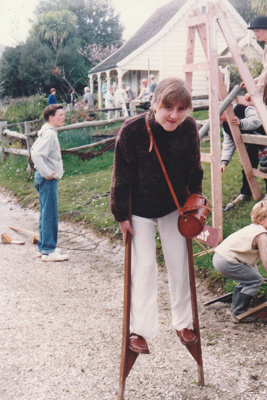 A girl on stilts and other children playing games in Howick Historical Village.; La Roche, Alan; 20 September 1992; P2021.125.08