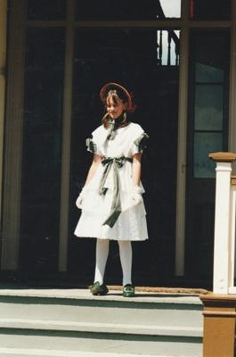 Blythe Southern in costume on Puhinui verandah on HHV Live Day. ; Palmer, Ros; October 2003; 2019.198.05