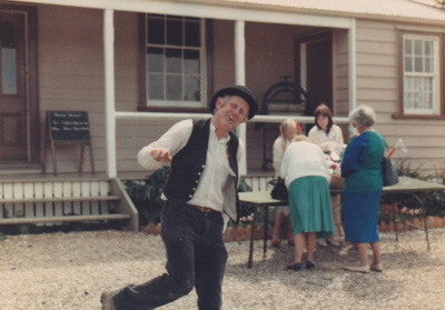 Alan la Roche (in costume) outside Eckford's Homestead in Howick Historical Village on a Live Day.; 1986; P2021.118.04
