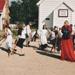 School children and a teacher stilt walking in Howick Historical Village.; La Roche, Alan; P2021.125.02