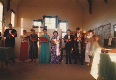 A choir singing in Pakuranga School in the Howick Historical Village at Christmas time. ; P2020.68.01