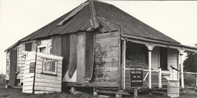 Colonel de Quincey's cottage after its removal to Howick Historical Village, before restoration.; Eastern Courier; c1979; P2020.112.01