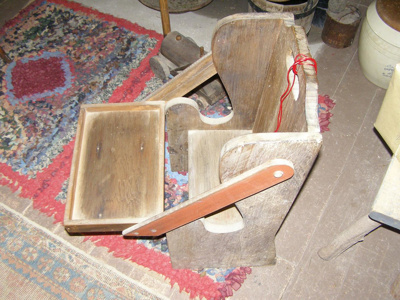 Wooden high chair with tray.
